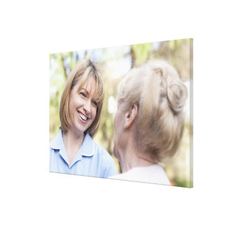 Nurse smiling and talking to a senior woman gallery wrapped canvas