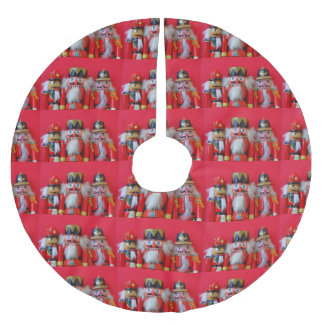 Nutcrackers in red uniforms brushed polyester tree skirt