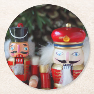 Nutcrackers with holiday background round paper coaster