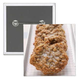 Oat biscuits on plate 15 cm square badge