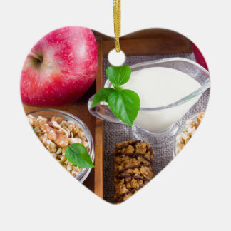 Oat cereal with nuts and raisins ceramic heart decoration