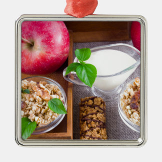 Oat cereal with nuts and raisins metal ornament