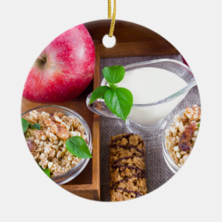 Oat cereal with nuts and raisins round ceramic decoration