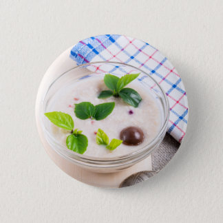 Oatmeal in a bowl of glass with chocolate candy 6 cm round badge
