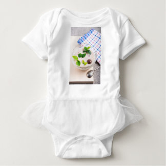 Oatmeal in a bowl of glass with chocolate candy baby bodysuit