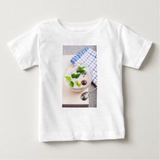 Oatmeal in a bowl of glass with chocolate candy baby T-Shirt