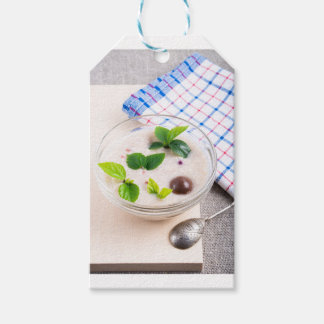 Oatmeal in a bowl of glass with chocolate candy gift tags
