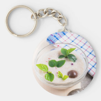 Oatmeal in a bowl of glass with chocolate candy key ring