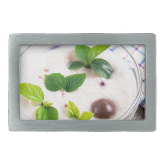Oatmeal in a bowl of glass with chocolate candy rectangular belt buckle
