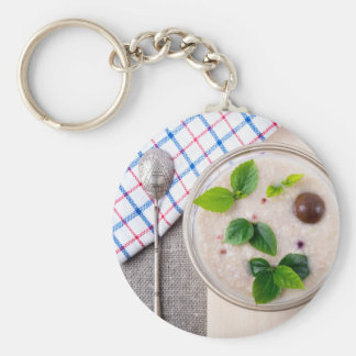 Oatmeal with chocolate candy and a silver spoon key ring