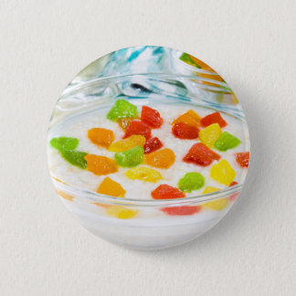 Oatmeal with colorful candied fruits in a glass 6 cm round badge