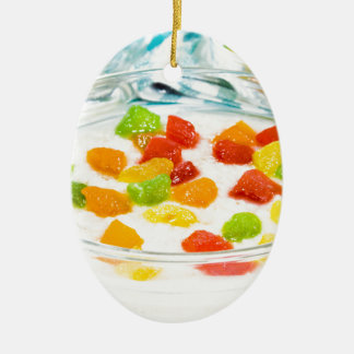 Oatmeal with colorful candied fruits in a glass ceramic oval decoration
