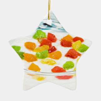 Oatmeal with colorful candied fruits in a glass ceramic star decoration