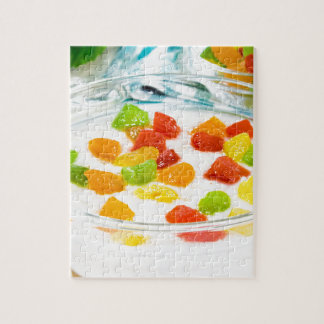 Oatmeal with colorful candied fruits in a glass jigsaw puzzle