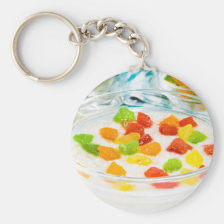 Oatmeal with colorful candied fruits in a glass key ring