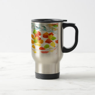 Oatmeal with colorful candied fruits in a glass travel mug