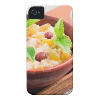 Oatmeal with raisins and berries in a wooden bowl Case-Mate iPhone 4 cases
