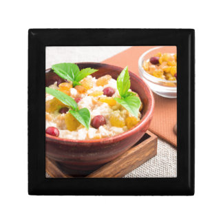 Oatmeal with raisins and berries in a wooden bowl gift box