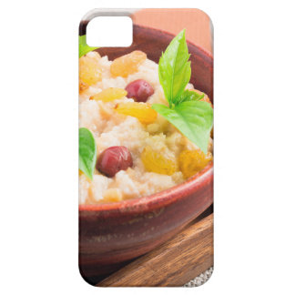 Oatmeal with raisins and berries in a wooden bowl iPhone 5 cases