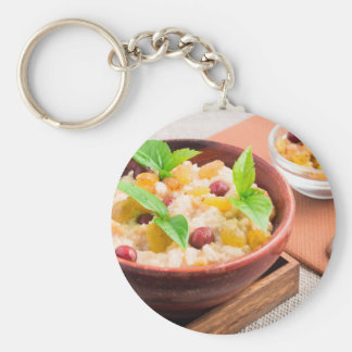 Oatmeal with raisins and berries in a wooden bowl key ring