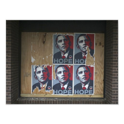 Obama signs in a boarded window of a closed photo art
