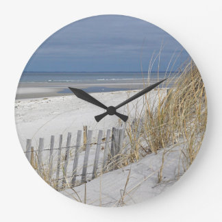 Ocean beach and sand fence large clock