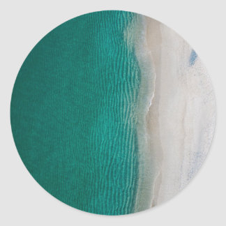 Ocean beach beautiful green water and white sands classic round sticker