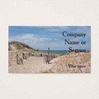 Ocean beach scene with dune fence and sandy path business card