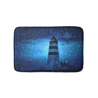 Ocean lighthouse a dark blue night with drops bath mat