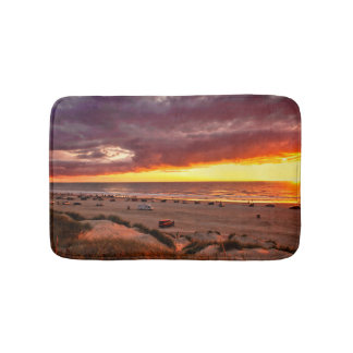 Ocean sunset with spectators on the beach bath mat