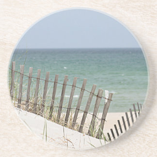 Ocean view through the beach fence coaster