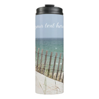 Ocean view through the beach fence thermal tumbler