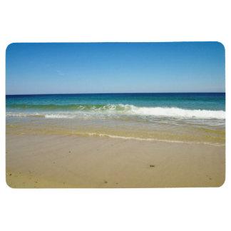 Ocean waves and sandy beach floor mat