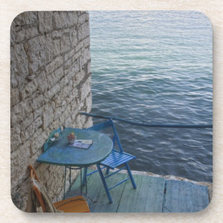 Oceanside seating for two at tiny outdoor cafe, drink coasters