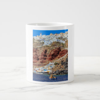 Oia village on Santorini island, north, Greece Giant Coffee Mug