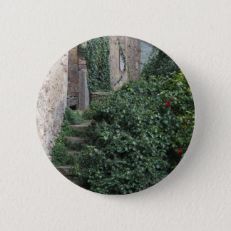 Old abandoned country homestead in the woods 6 cm round badge