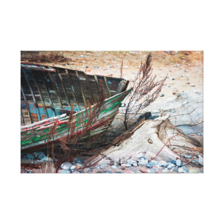Old Abandoned Wooden Boat and Driftwood on Beach Canvas Print