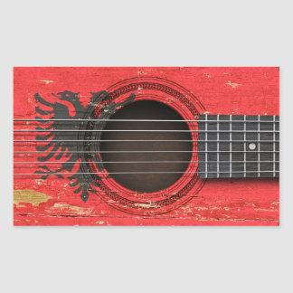 Old Acoustic Guitar with Albanian Flag Stickers