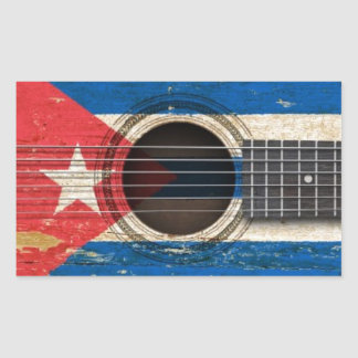 Old Acoustic Guitar with Cuban Flag Stickers