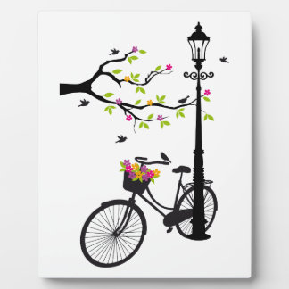 Old bicycle with lamp, flower basket, birds, tree plaque