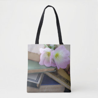 Old books with primroses tote bag