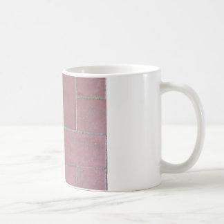 Old brick footpath background basic white mug