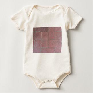 Old brick footpath background baby bodysuits