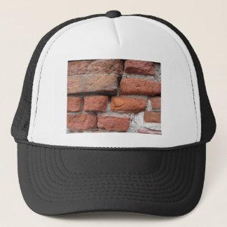 Old brick wall background trucker hat