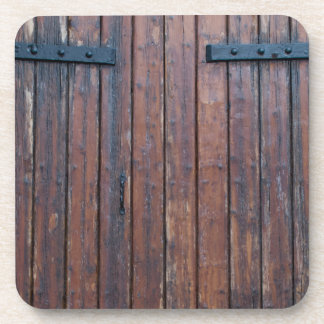 Old Brown Wood Doors With Black Iron Supports Drink Coasters
