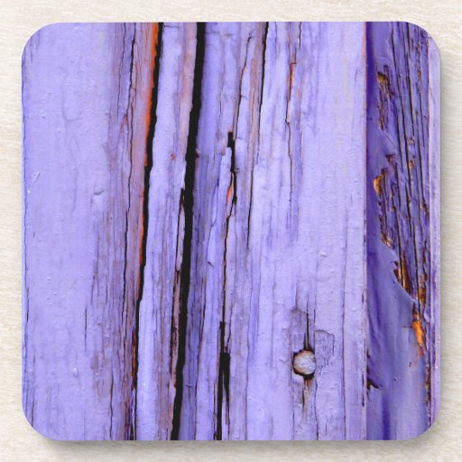 Old cracked purple paint on wood coasters
