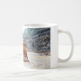Old Damaged Excavator Sitting In A Rock Quarry Basic White Mug
