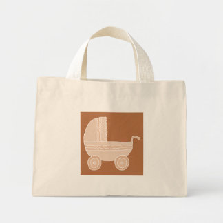 Old Fashioned Beige Baby Stroller on Brown. Mini Tote Bag
