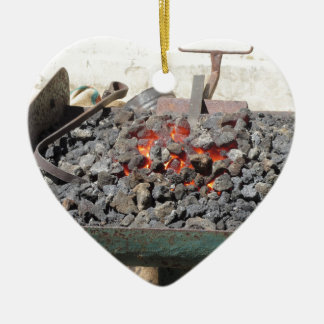 Old-fashioned blacksmith furnace . Burning coals Ceramic Heart Decoration