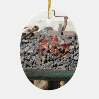 Old-fashioned blacksmith furnace . Burning coals Ceramic Oval Decoration